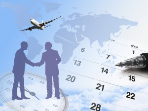 composite of calendar and world map and airplane.